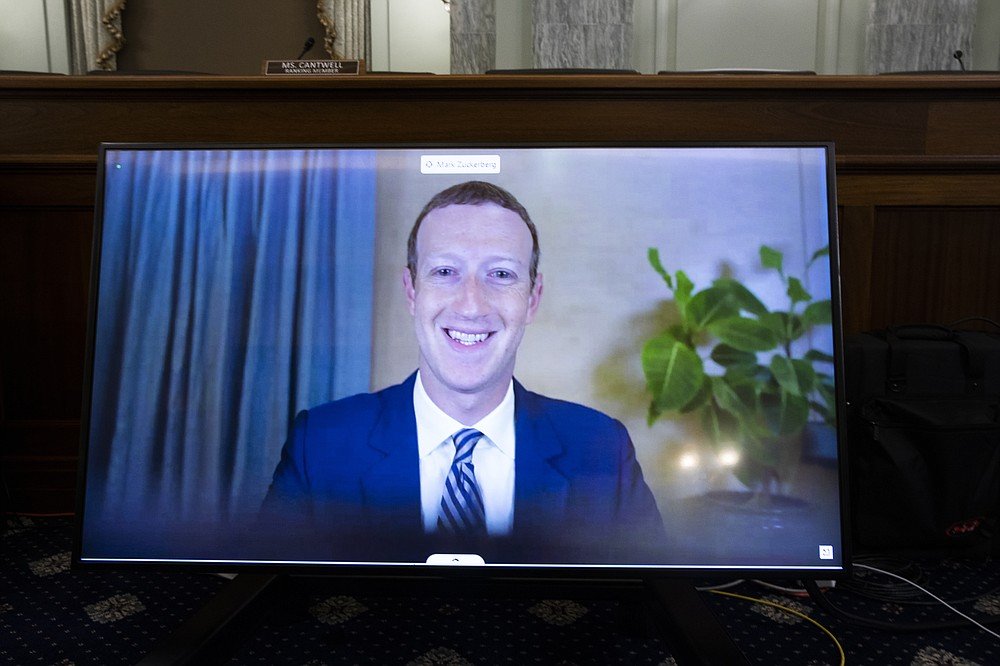 Facebook CEO Mark Zuckerberg appears on a screen as he speaks remotely during a hearing before the Senate Commerce Committee on Capitol Hill, Wednesday, Oct. 28, 2020, in Washington. The committee summoned the CEOs of Twitter, Facebook and Google to testify. (Michael Reynolds/Pool via AP)