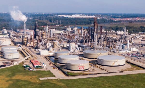The Exxon Mobil oil refinery in Channahon, Ill. The industry has been hurt by the pandemic as lockdowns reduce the demand for oil and gas.