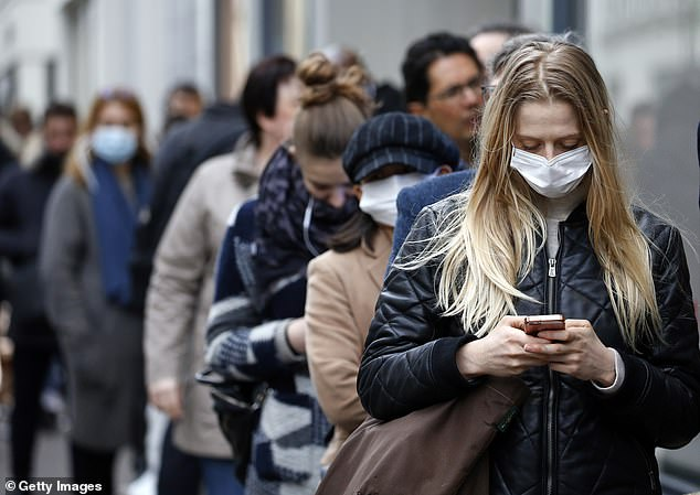 Fewer than half of all Americans wear masks in public 'always,' but near-universal masking hs been achieved in some neighborhoods of New York (file)