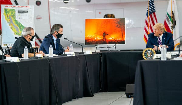 Gov. Gavin Newsom of California, second from left, pushed President Trump to acknowledge the role of climate change during a briefing last month on the fires ravaging the West.