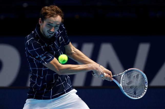 Daniil Medvedev of Russia hits a return during his singles match against Novak Djokovic of Serbia  during Day 4 of the Nitto ATP World Tour Finals at The O2 Arena on November 18, 2020 in London, England.