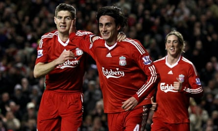 Alberto Aquilani celebrates alongside Steven Gerrard after scoring against Portsmouth in March 2010, the first of his two goals for Liverpool.