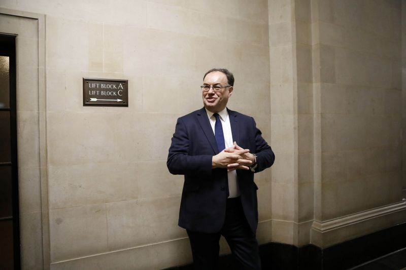 © Reuters. Bank of England Governor Andrew Bailey poses for a photograph on the first day of his new role at the Central Bank in London