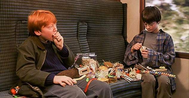 Stanford researchers examined the 250 top-grossing American movies of recent decades and found the on-screen foods and beverages largely failed UK youth advertising standards. Pictured, a scene from Harry Potter and the Philosopher's Stone, where Ron and Harry eat fictional sweets