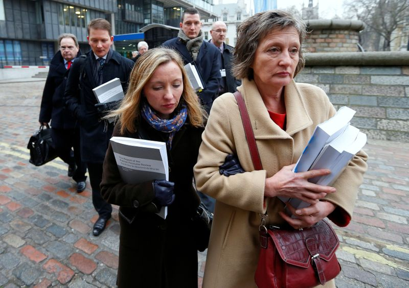 © Reuters. FILE PHOTO: Geraldine Finucane, the widow of murdered Belfast solicitor Pat Finucane, arrives for a media conference with her children Katherine, Michael and John  in central London