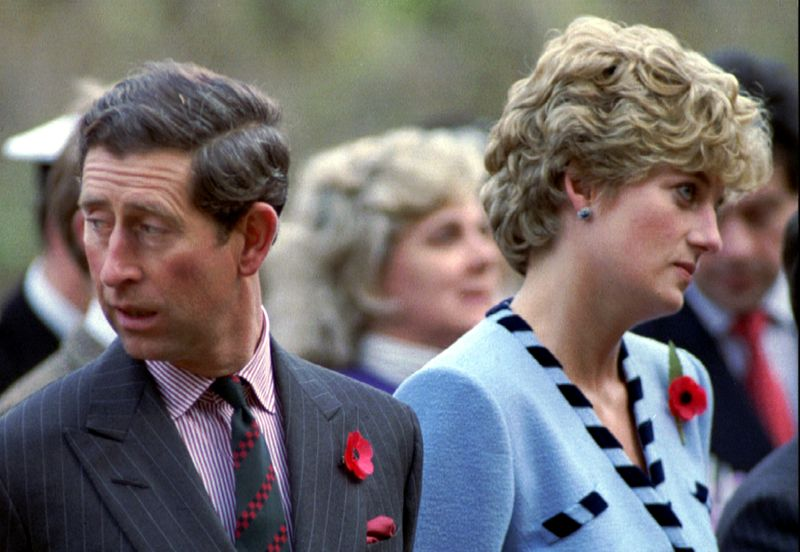 © Reuters. FILE PHOTO: Princess Diana and Prince Charles look in different directions, November 3, during a service held to..