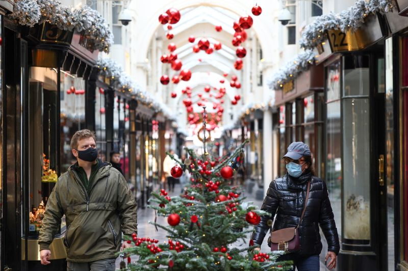 © Reuters. People walk through the Burlington Arcade adorned with Christmas decorations, in London