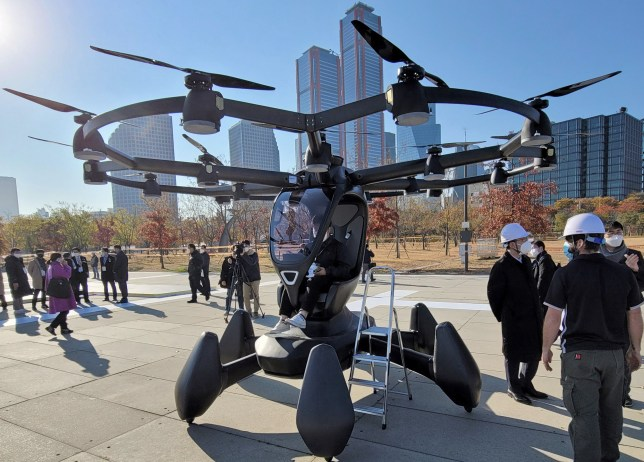 SEOUL, SOUTH KOREA - NOVEMBER 11, 2020: People attend a presentation of delivery drones and drone taxis at a take-off site by the Hangang River. According to South Korea's Ministry of Transport, the launch of unmanned aerial taxis is planned for 2028. Stanislav Varivoda/TASS (Photo by Stanislav Varivoda\TASS via Getty Images)