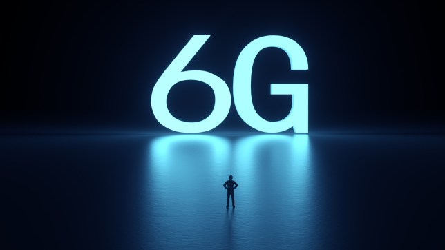 Man standing in front of a giant 6G sign