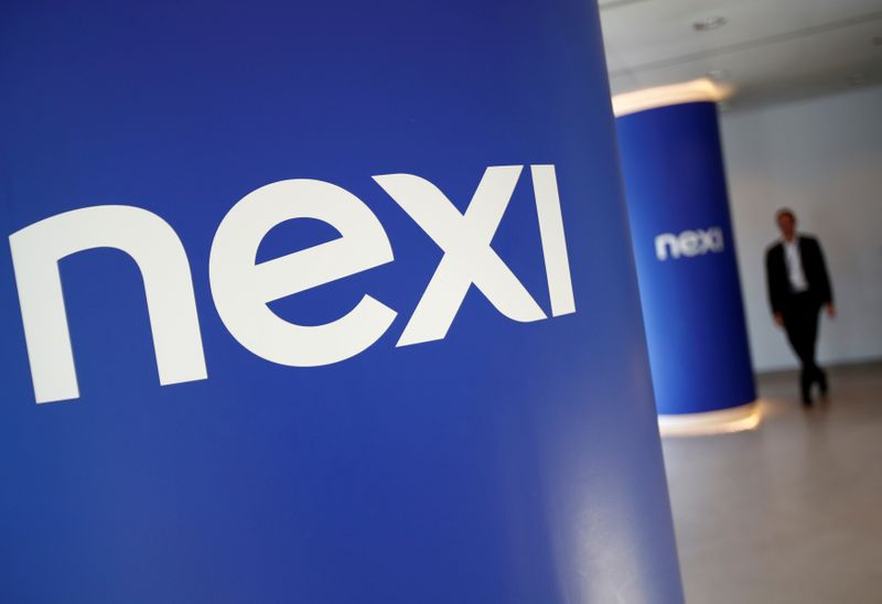 © Reuters. FILE PHOTO: The logo of Italian payments group Nexi is pictured inside their headquarters in Milan