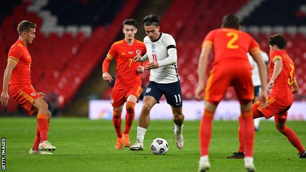 Jack Grealish (centre) in action for England against Wales