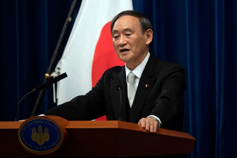 © Reuters. FILE PHOTO: Yoshihide Suga speaks during a news conference following his confirmation as Prime Minister of Japan in Tokyo