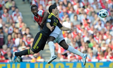 Djourou challenges Liverpool's Luis Suárez in a Premier League 1-1 draw at the Emirates in 2011.