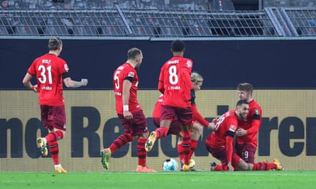 Ellyes Skhiri is mobbed by his teammates after scoring Köln's decisive second goal.