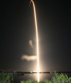 A SpaceX Falcon 9 rocket streaks toward space