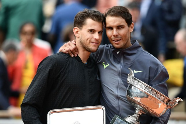 Winner Spain's Rafael Nadal (R) and second-placed Austria's Dominic Thiem (L) pose with their trophies at the end of the men's singles final match against Austria's Dominic Thiem on day fifteen of The Roland Garros 2019 French Open tennis tournament in Paris on June 9, 2019.