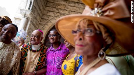 Archbishop Wilton Gregory, second from left, greets parishioners following mass at St. Augustine Church in Washington on June 2, 2019.