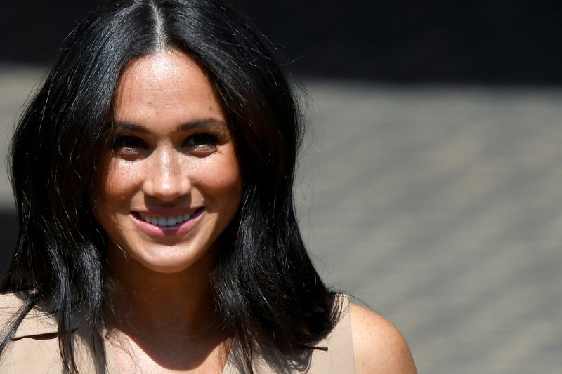 © Reuters. FILE PHOTO: Britain's Meghan Markle, Duchess of Sussex, visits the University of Johannesburg
