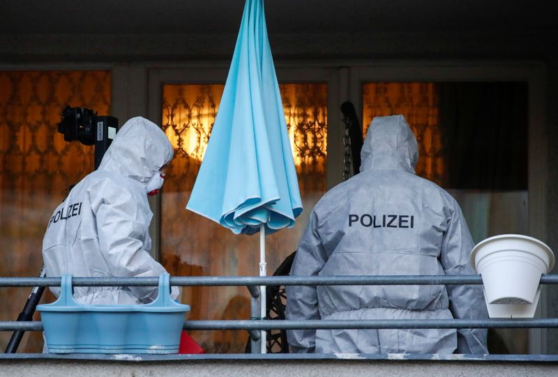 © Reuters. Police forensic officers work at the scene during raids in Berlin