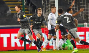Adam Reach (left) turns away after scoring for Sheffield Wednesday at Swansea.