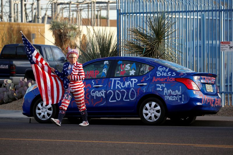 © Reuters. FILE PHOTO: Supporters of U.S. President Donald Trump gather for a
