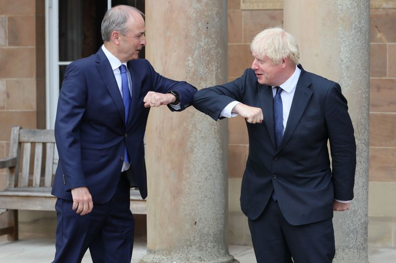© Reuters. Britain's Prime Minister Boris Johnson and Ireland's Prime Minister (Taoiseach) Micheal Martin greet each other with an elbow bump at Hillsborough Castle, in Belfast