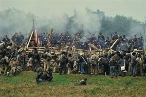 Photo of re-enactors portraying the fighting at the Sunken Road during the Battle of Antietam.