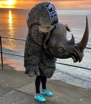woman on seafront in rhino costume and trainers