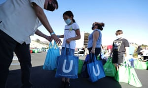 YMCA volunteers hand out Thanksgiving turkeys to Los Angeles students in need, as the global outbreak of the coronavirus disease (COVID-19) continues, in Los Angeles, California, US, 16 November 2020.