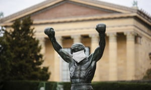 The Rocky statue is outfitted with a mock surgical face mask at the Philadelphia Art Museum in Philadelphia.