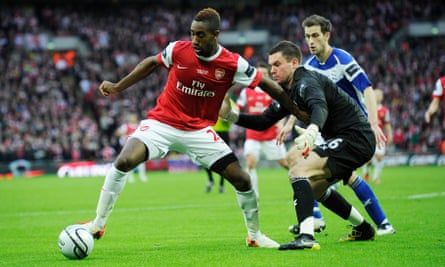 Djourou holds off Birmingham goalkeeper Ben Foster during the 2011 Carling Cup final at Wembley, a defeat that had disastrous consequences for the best season of the defender's Arsenal career.