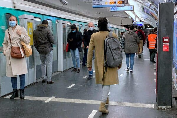 Commuters wait for a train on the Paris underground last week. France's latest lockdown is taking less of a toll on the economy than the shutdown imposed earlier this year, the central bank said.