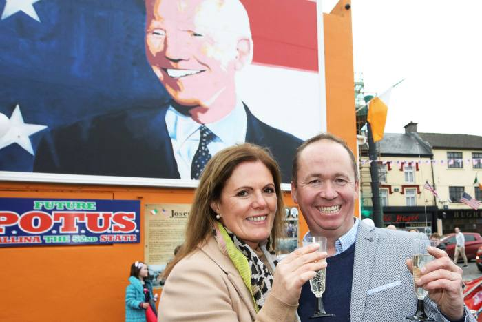 Joe Blewitt, a cousin of Joe Biden, and his wife Deirdre celebrate the US election results on Saturday in front of a mural of the president-elect at his ancestral home in Ballina, County Mayo, Ireland