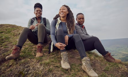 Rhiane Fatinikun, with two other women, all in walking boots on top of a hill