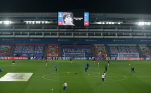 An image of a young Diego Armando Maradona is shown on the big screen as the players warm up at Selhurst Park.