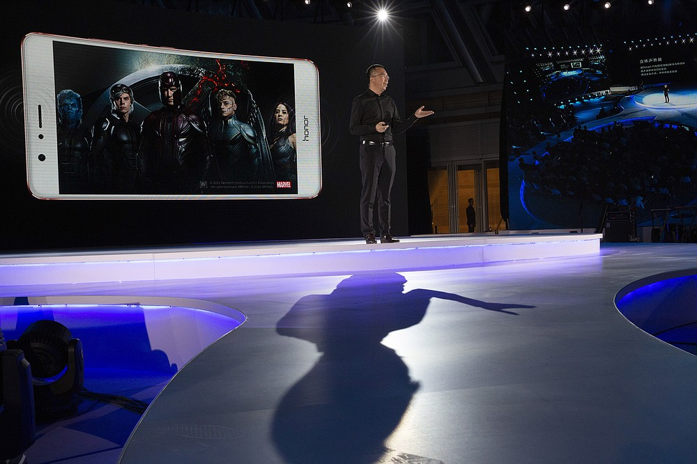 George Zhao, Huawei's Honor brand president speaks during an event to launch one of its mobile phone in Beijing, China, Tuesday, May 10, 2016. In an announcement Tuesday, Nov. 17, 2020, Chinese tech giant Huawei says it is selling its budget-price Honor smartphone brand in an effort to rescue the struggling business from damaging U.S. sanctions imposed on its parent company. (AP Photo/Ng Han Guan)