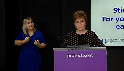 Ms Sturgeon, the Scottish First Minister, said that she had 'no plans' to alter the 14-day period, with her top medic suggesting there was currently no evidence to support it.