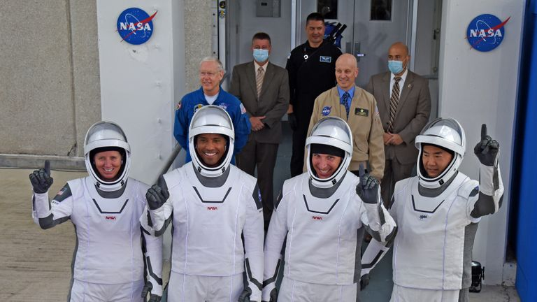 CAPE CANAVERAL, FL - NOVEMBER 15:  (L-R) NASA astronauts, mission specialist Shannon Walker, vehicle pilot Victor Glover, commander Mike Hopkins and mission specialist from the Japan Aerospace Exploration Agency (JAXA), astronaut Soichi Noguchi walk out of the Operations and Checkout Building November 15, 2020 on their way to the SpaceX Falcon 9 rocket with the Crew Dragon spacecraft on launch pad 39A at the Kennedy Space Center on November 15, 2020 in Cape Canaveral, Florida. This will mark the second astronaut launch from U.S. soil by NASA and SpaceX and the first operational mission named Crew-1 to the International Space Station. (Photo by Red Huber/Getty Images)