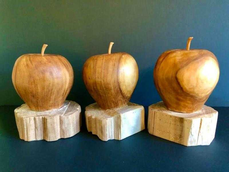 """Hafey said he struggled against the grain of the wood write the curved numbers of """"2020."""" So he chiseled the year in Roman numerals. """"It was all straight lines,"""" Hafey said. Hafey did present the apples to his daughters. And they were all touched to receive them, he said."""