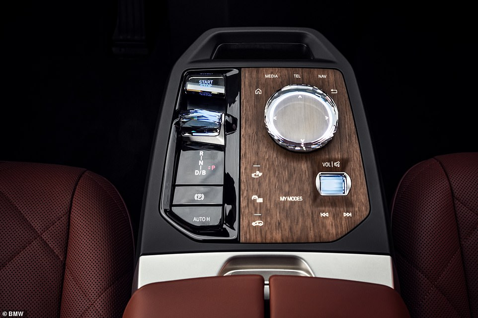 The lack of a conventional petrol or diesel engine and drivetrain means there is no central tunnel running through the cabin. Instead, there's a  flashy centre console BMW says is 'crafted to look like a high-quality piece of furniture'