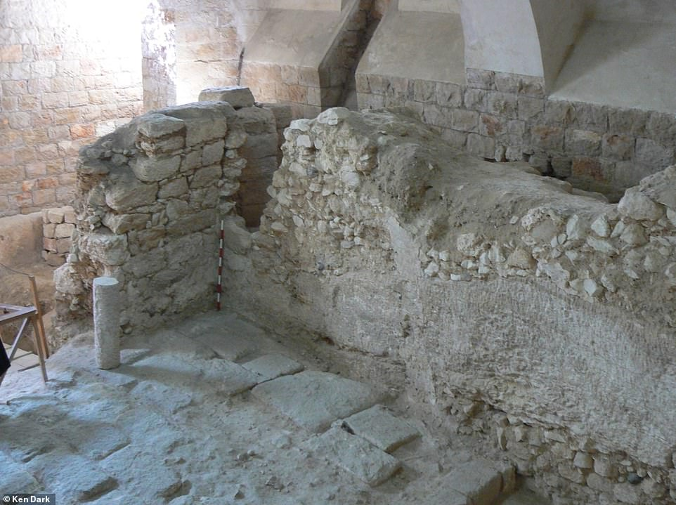 The first-century house showing one of its rock-cut walls. The position of the scale indicates the line of a crusader-period vault