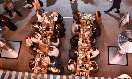 People eat at a restaurant at night in Tokyo.