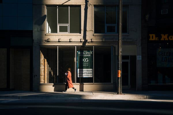 An empty storefront in Chicago this week. A government report warned on Wednesday that many U.S. households and businesses might be unable to recover without government help.