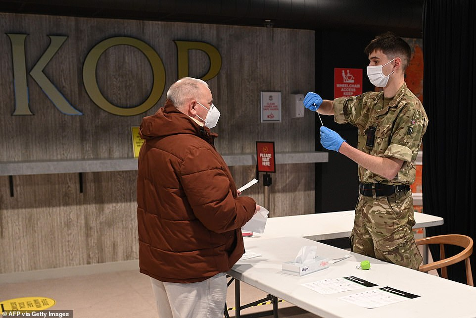 A soldier is pictured staffing a coronavirus swab testing centre at Anfield Stadium in Liverpool