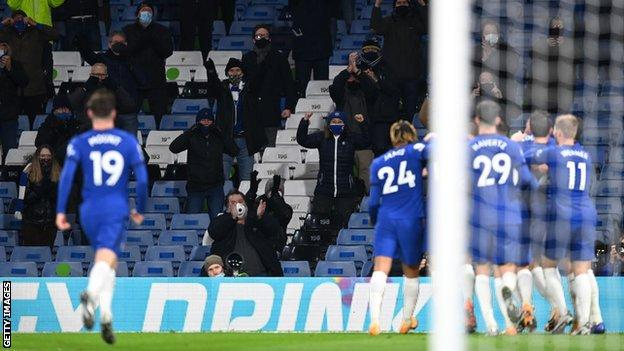 Chelsea players celebrate in front of their fans against Leeds