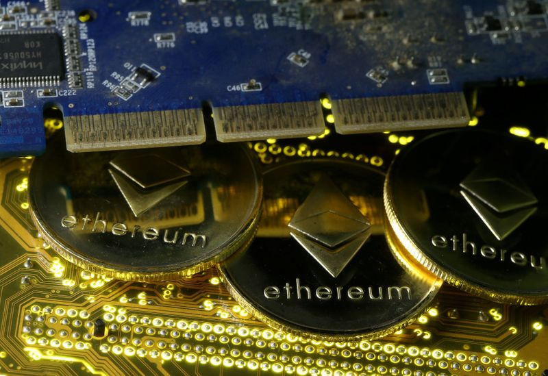 © Reuters. FILE PHOTO: Representations of the Ethereum virtual currency standing on the PC motherboard are seen in this illustration picture