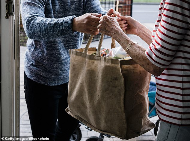Trusting: Thousands of people now depend on others to do their shopping, withdraw cash and pay bills on their behalf because of the pandemic