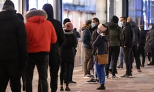 Shoppers queue outside Next in Leicester on Boxing Day morning.