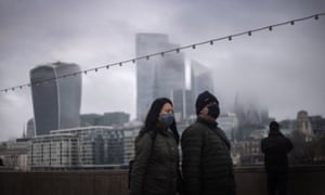A couple walking past a view of the City of London.