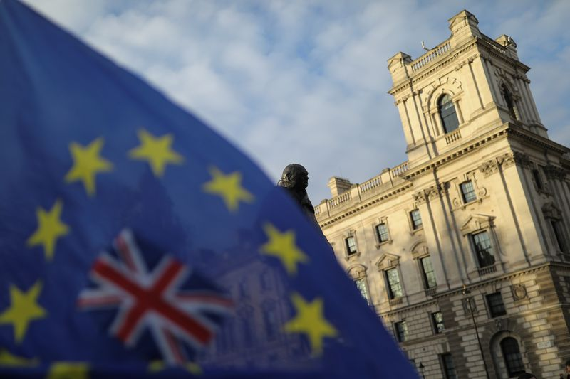 © Reuters. FILE PHOTO: A flag is seen outside the Houses of Parliament near the statue of former Prime Minister Winston Churchill in London